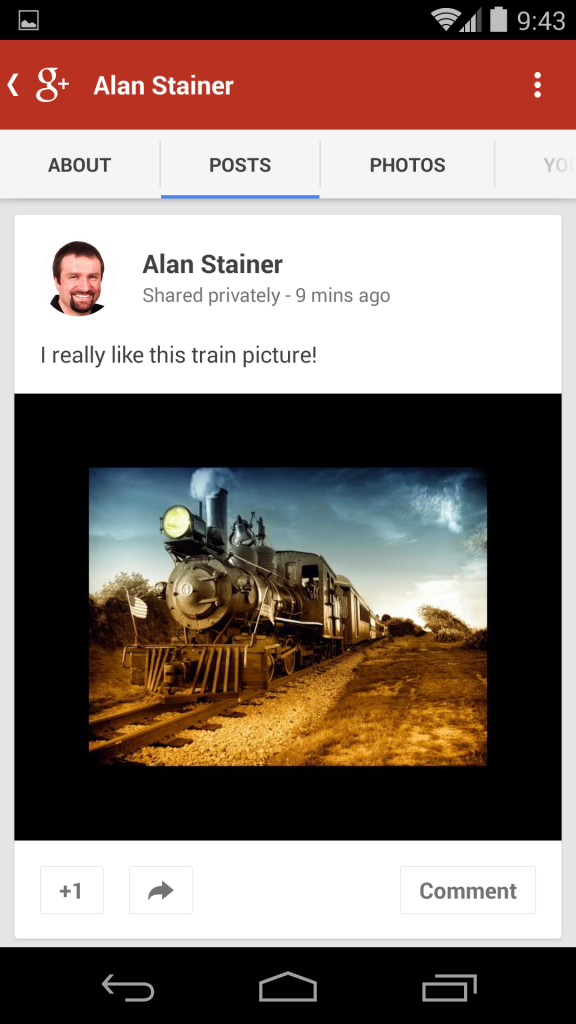 A steam train picture with a bordered viewed on a smartphone